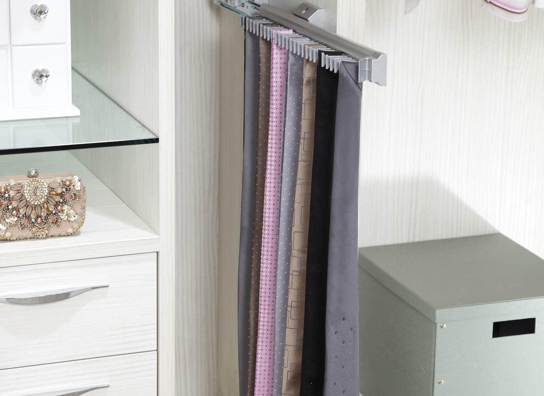 Detail of bespoke walk in wardrobe with tie rack