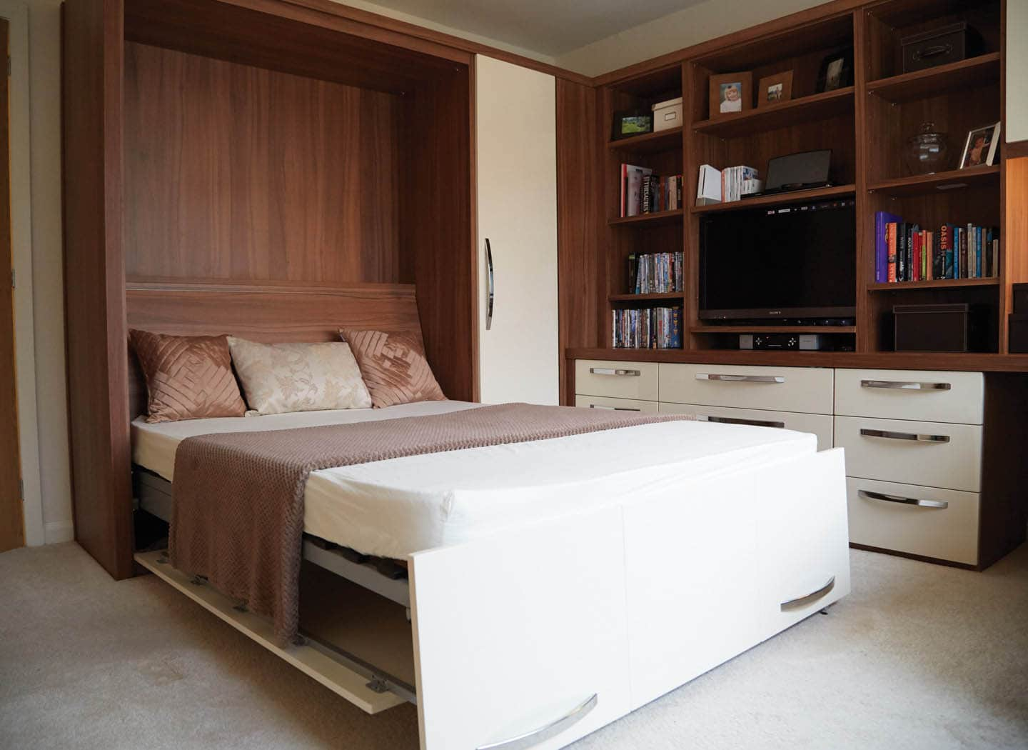 Fitted lounge with open wall bed