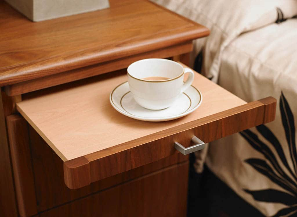 Bedside table with pull out coffee tray