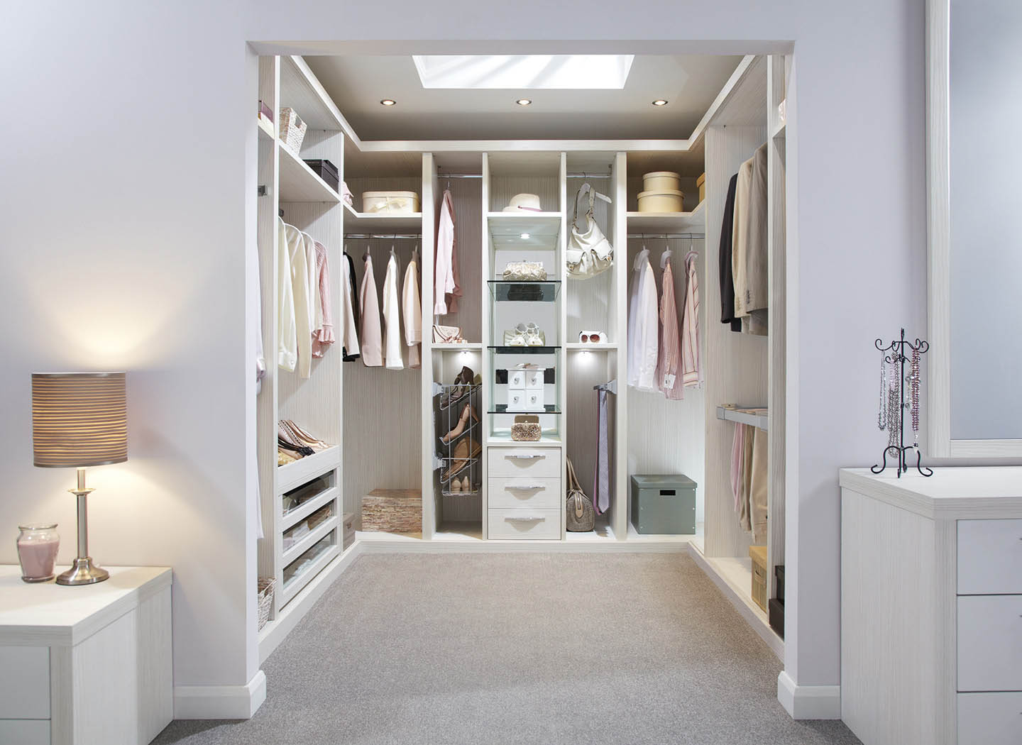 Fitted white walk in wardrobe
